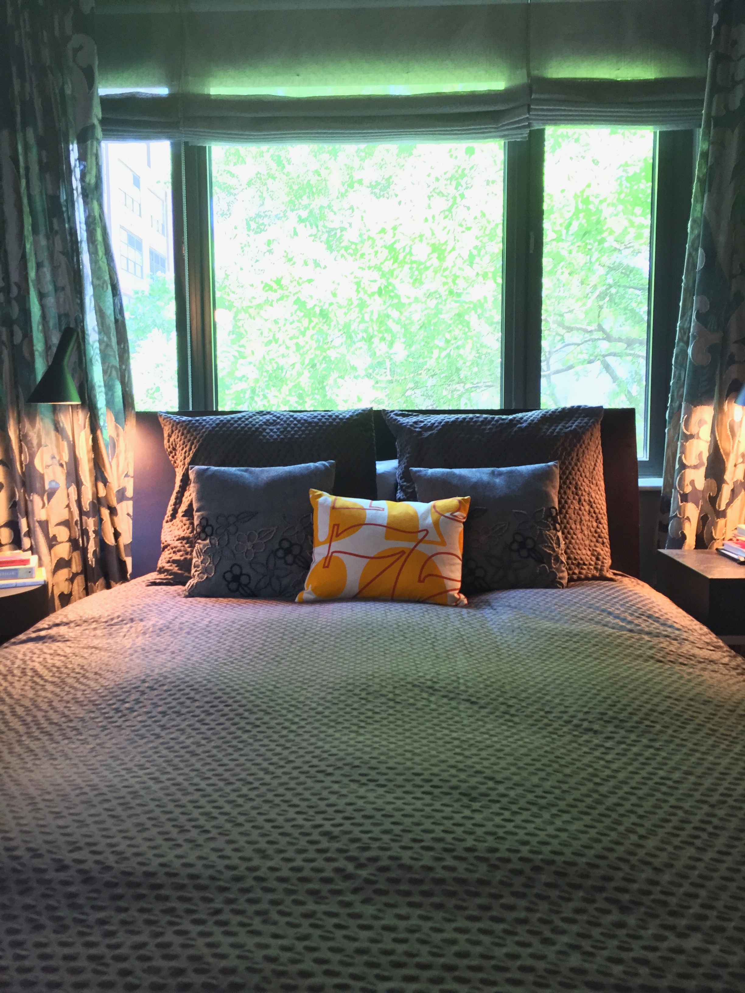 Light filters through the trees outside and keeps the bedroom bright yet cozy