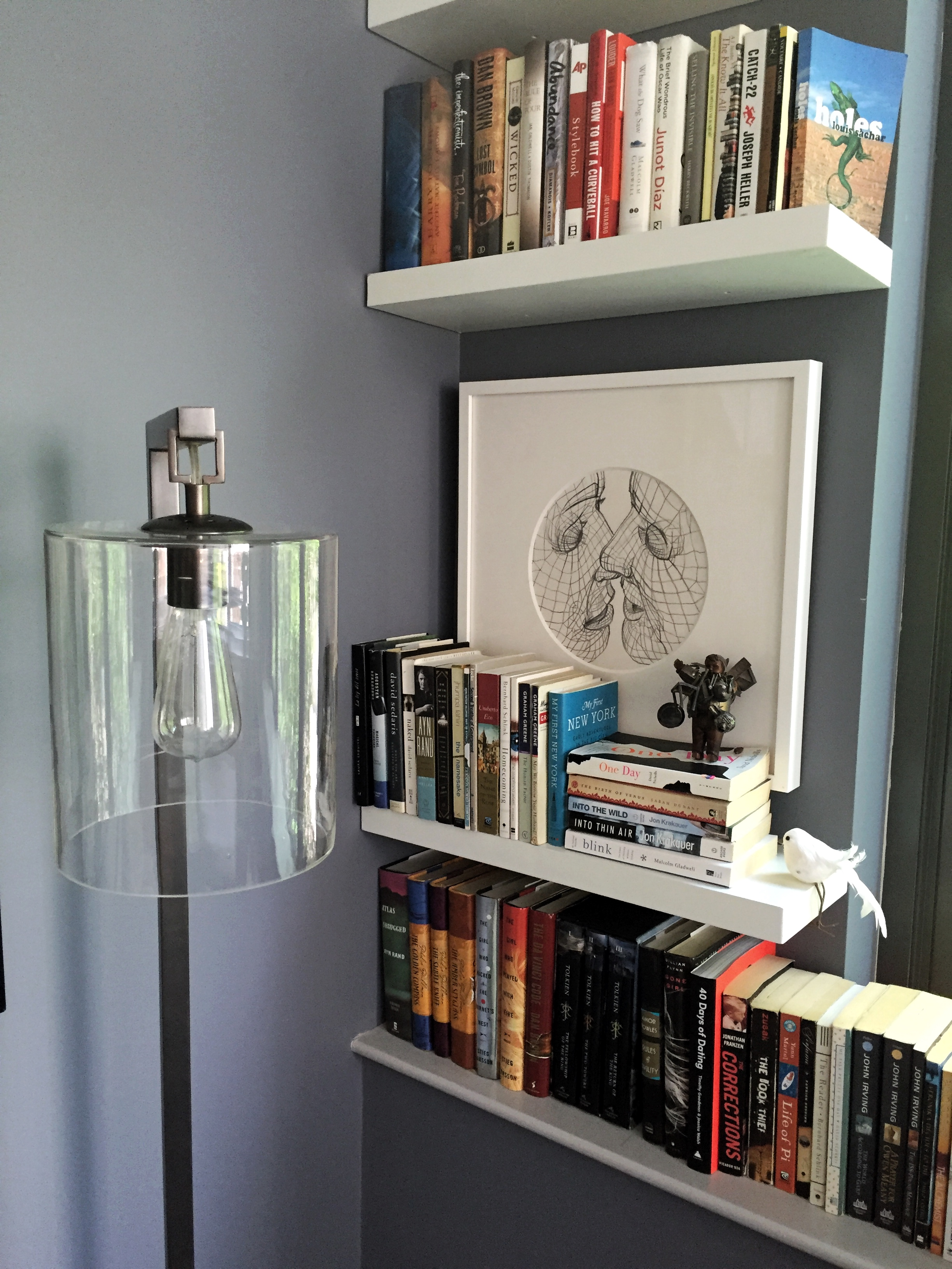 """I'm definitely a book lover. My dream home would have a huge library. In the meantime we have a little corner right next to the window where we have a collection of books that we've read and small travel pieces that we've purchased."""